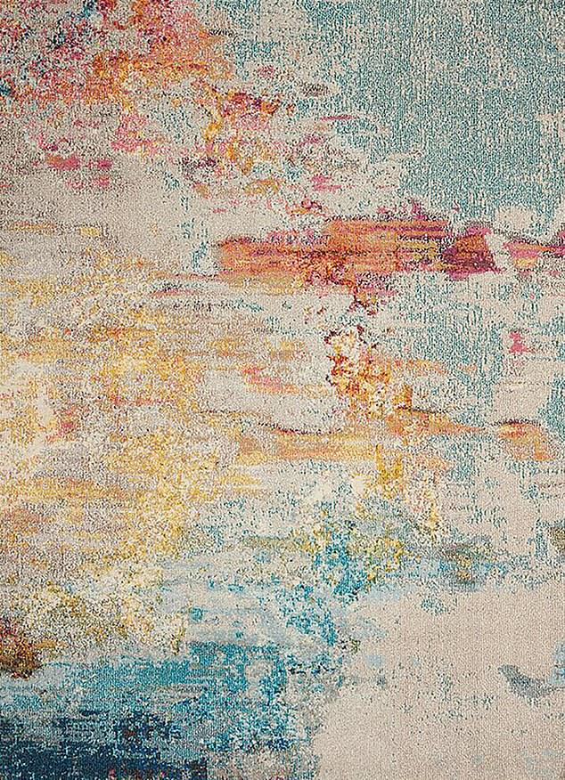 Softer tones: Raucher blue/gray rug (£48.99) would suit a more contemporary interior