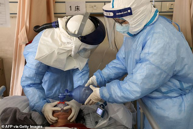 One study found that 7.3% of mild to moderate COVID-19 patients treated with the drug were either hospitalized or died at the end of 30 days, compared with 14.1% of those taking the dummy pill. in comparison.  Image: Medical staff treat a COVID-19 patient in Wuhan, February 2020
