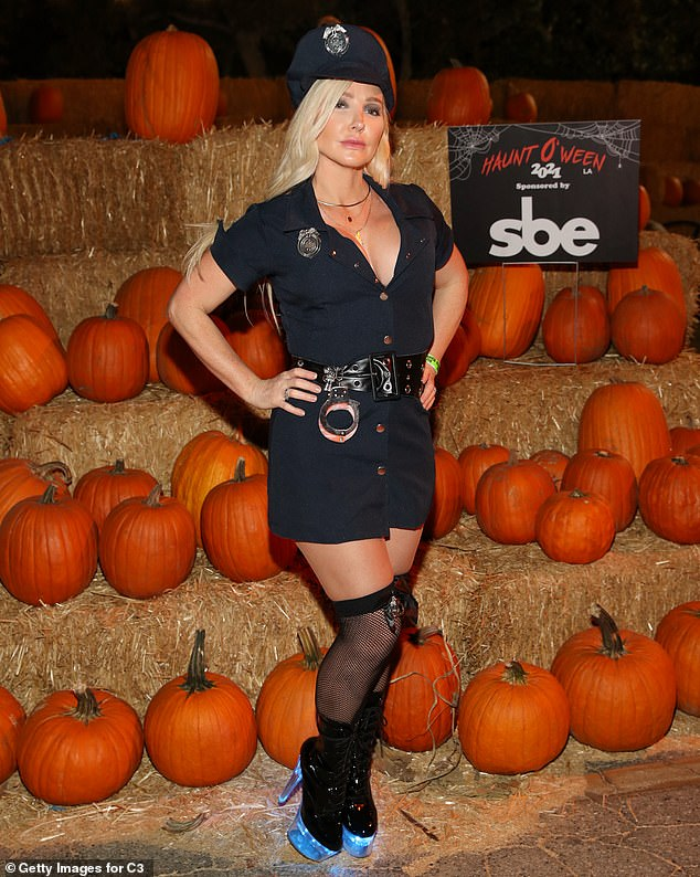 Ready to rock:Also at the event was U & I singer Nikki Lund. The longtime friend of Kim Kardashian was dressed up as a police officer for her Halloween costume. She even had a pair of handcuffs around her belt