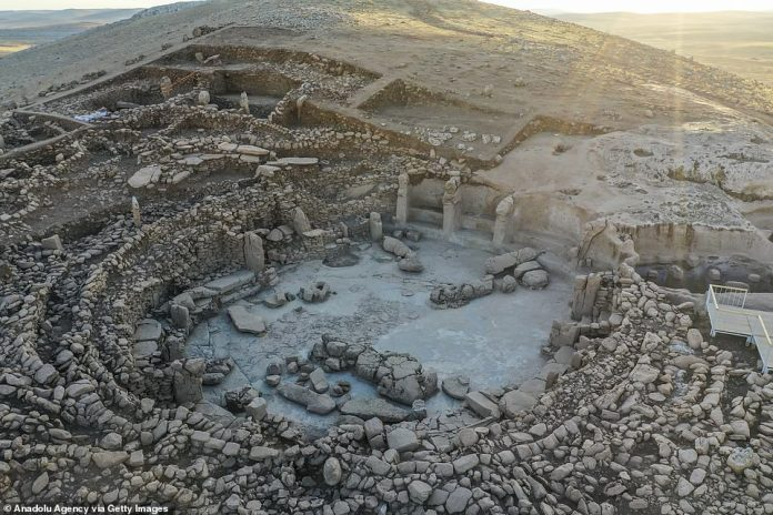 They may have come together 11,500 years ago to carve the T-shaped pillars with stone tools, using rope, log beams and manpower, before carrying them to the top of the hill.