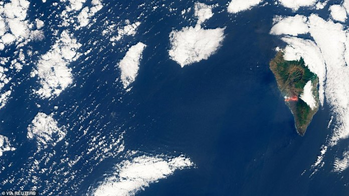 The Spanish Canary Islands in Africa's northwest continue to expand (pictured in a satellite image) as lava from the volcano hardens when it comes into contact with water, scientists have said