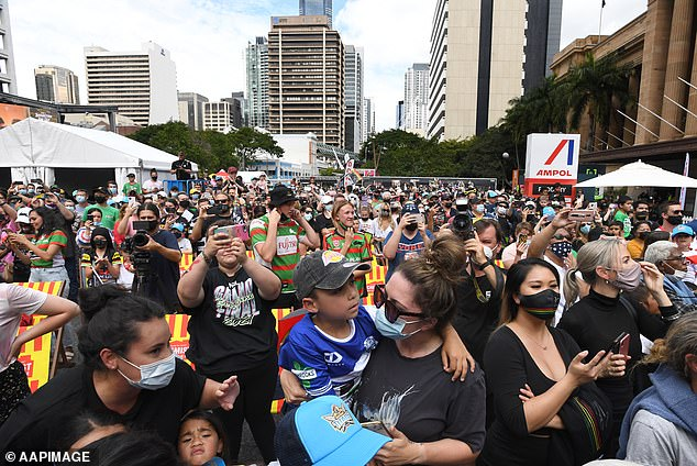 The NRL is likely to hold Sunday's grand final in Brisbane as planned after just two new cases of COVID-19 were recorded in Queensland on Saturday (pictured: Fans in attendance at the NRL Grand Final fan day at King George Square in Brisbane on Friday)