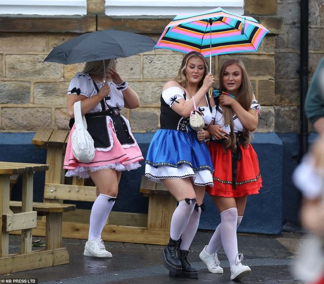 Some revellers decided that the use of umbrellas might save them from the worst of the rain across the city