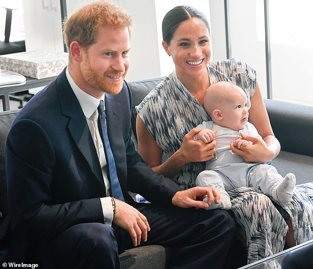 Insiders fear the Duke of Sussex (pictured with Meghan and Archie in South Africa in 2019) could use his upcoming memoir to expose the royal who questioned Archie's skin colour
