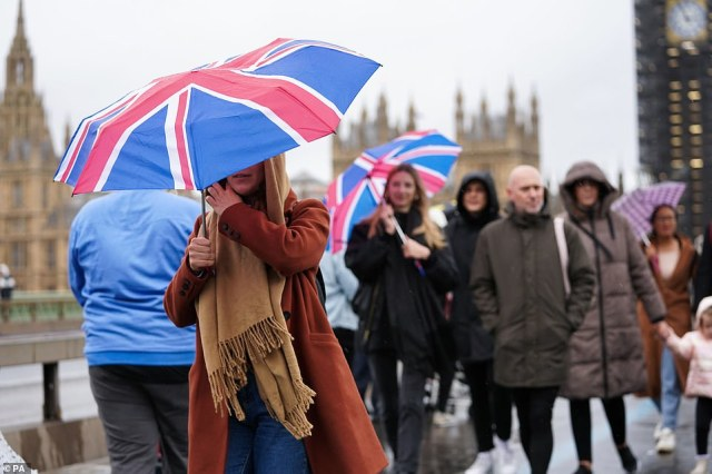 Visitors to central London battled wind and rain while trying to cross Westminster Bridge earlier today