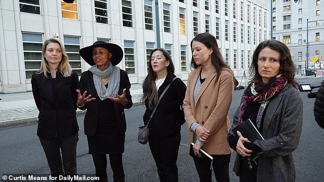 Roberts (far right) stood outside a New York City courthouse where Raniere's trial was held in 2016, still pleading allegiance to the group. The New York Health Department expressed that Roberts showed 'no remorse' during her hearing. The women she branded were a part of the DOS section of the group, which was a 'secret women's group' and the brandings were supposed 'building character, strength, and discipline' through pain