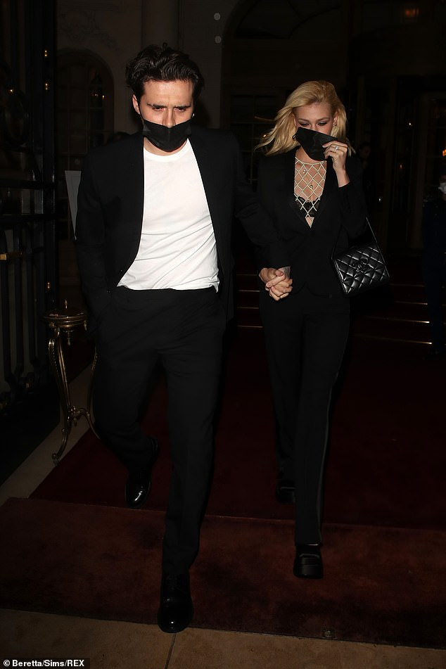 The couple: Brooklyn Beckham and fiancee Nicola Peltz continue to mingle with the stars as they were seen leaving their hotel in Paris during Fashion Week Saturday night