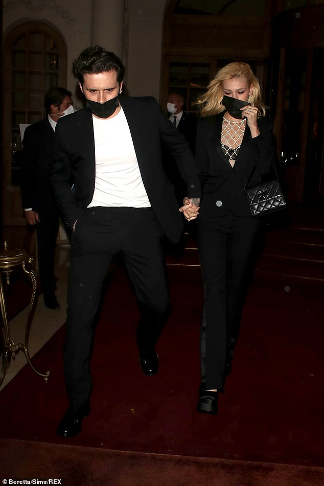 Romantic: The loving couple went hand in hand via City of Love and even coordinated their look for the evening