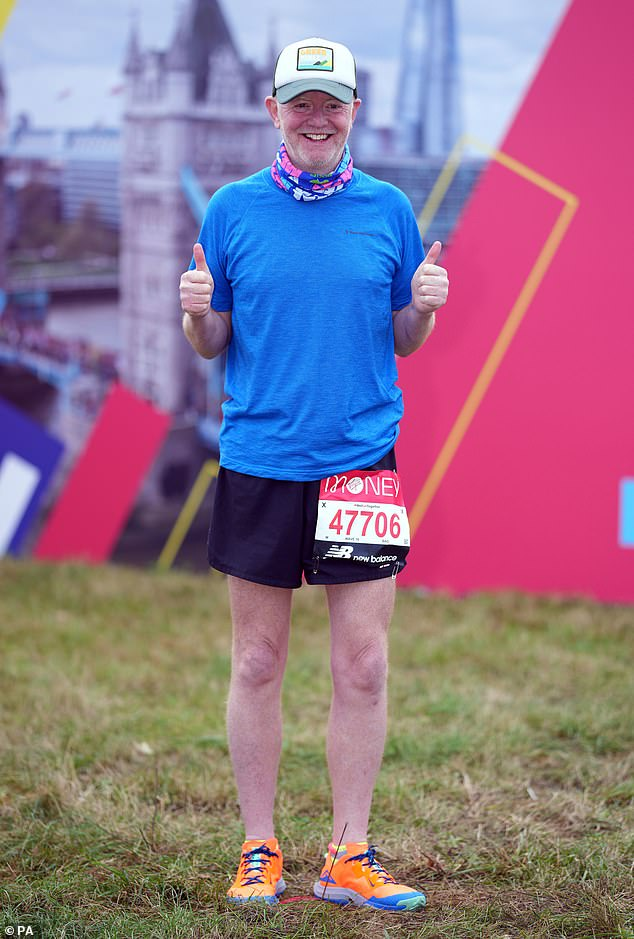 Ready to run: Chris Evans, 55, looks ready for action as he smiles at the starting line of the London Marathon on Sunday morning