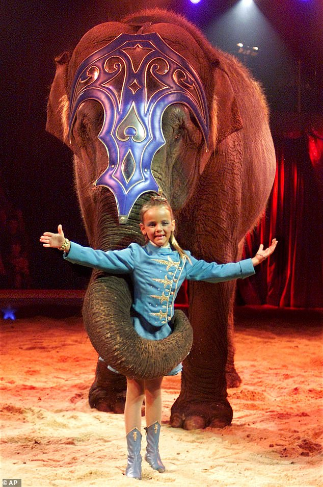 Princess Stephanie of Monaco's daughter is pictured being held by an elephant during a show at the Swiss National Circus Nie in Geneva in 2001