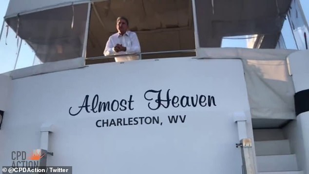 Sen. Joe Manchin, of West Virginia, spoke to protesters from aboard his $700,000 yacht