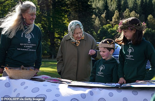 Next year's Platinum Jubilee pageant will be the 'biggest putt ever', organizers say - even the topping event held in 1897 for Queen Victoria's diamond milestone.  Pictured: Queen Elizabeth II (second from left) with children on October 1 at the start of the official planting season for the Queen's Green Canopy - part of the Platinum Jubilee initiative