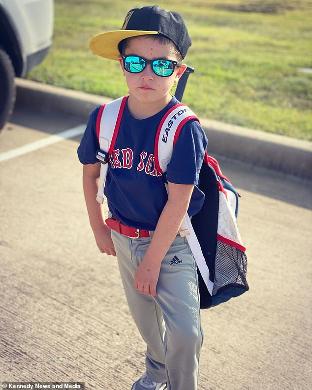 Ready for the game: Red Sox fan Beckett shows off his baseball kit as he resumes normal activities