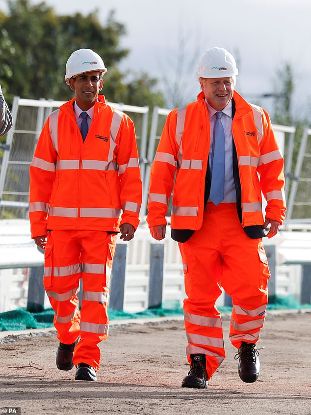Boris Johnson and Chancellor Rishi Sunak during a visit to a construction site in Manchester. Mr Johnson said all donations to the party are vetted