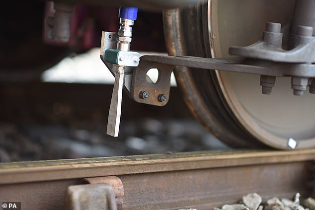 Innovation: Dry ice will be blasted on railway lines across northern England as part of a trial aimed at reducing delays caused by leaves on the track.  Leading leaf-clearing device (pictured) by British engineers could be rolled out across the UK by 2024