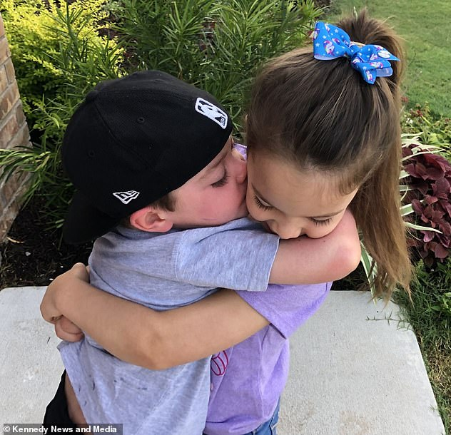 Inseparable siblings Beckett (right) and Aubrey (left) can be seen hugging during Beckett's treatment here in Princeton, Texas