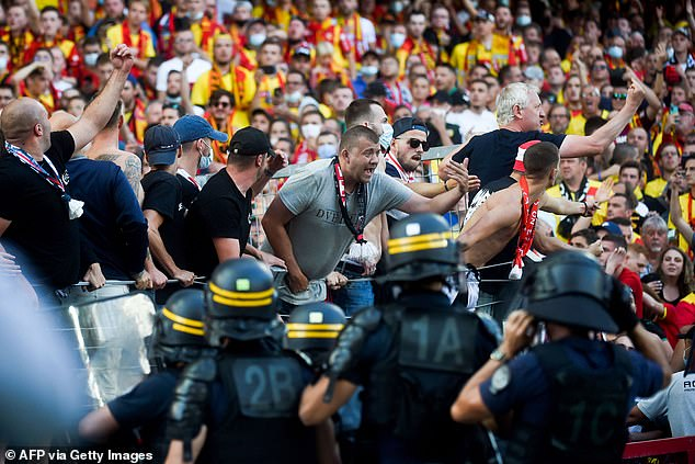 Lens supporters clash with riot police officers during their Ligue 1 clash against Lille