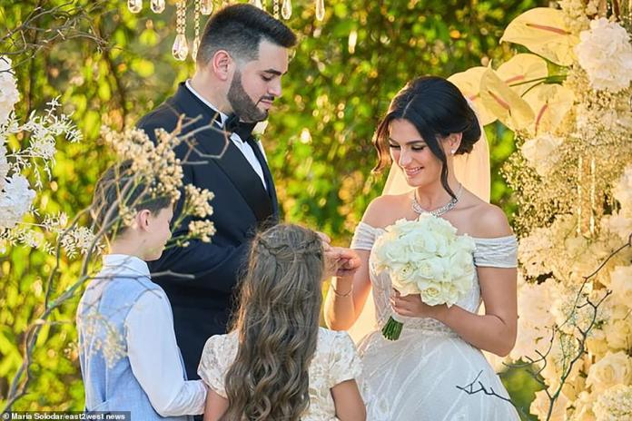 The stunning bride wore a Vera Wang outfit for the ceremony before changing into a Zuhair Murad number for the party.  he is painted on the altar