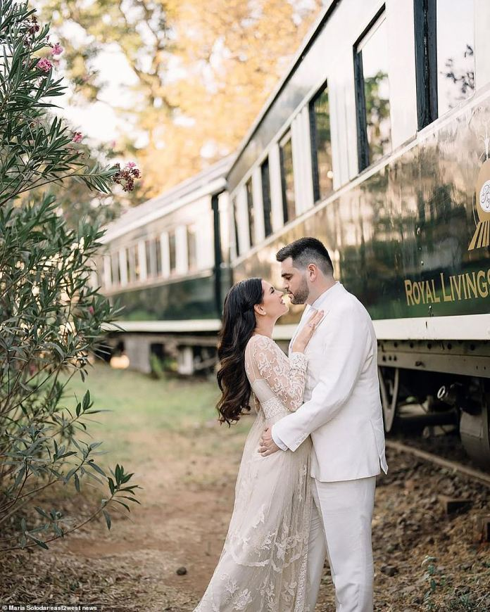 The guests were seen by the 1990s Russian band Ivanushki International with French stars Helena Segara and Damien Sarguez - the couple is pictured in front of a train