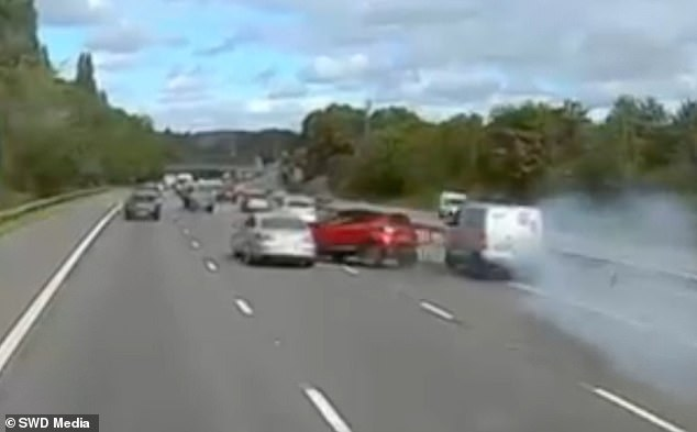 This is the shocking moment a van driver ploughs into the back of a car after failing to spot traffic slowing down up ahead on theM56 near Runcorn, Cheshire