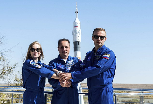 Actress Yulia Peresild, left, director Klim Shipenko' right, will spend 12 days filming on the station, but cosmonaut Anton Shkaplerov (center) will stay for six months