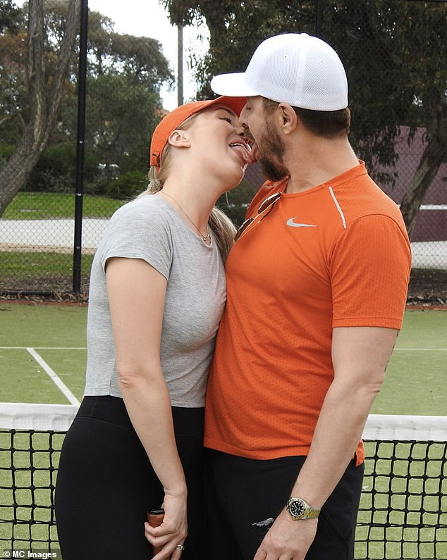 Look away Jo! James Susler, 45, (right) gets handsy as he packs on the PDA with his actress girlfriend Verity East (left) during a game of tennis on Sunday in Melbourne