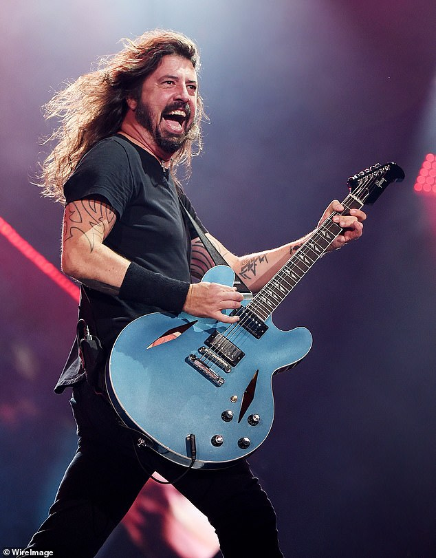 Change from his usual gig: Dave is best known for his time as Foo Fighters frontman as well as in the iconic band Nirvana (pictured July 2018)