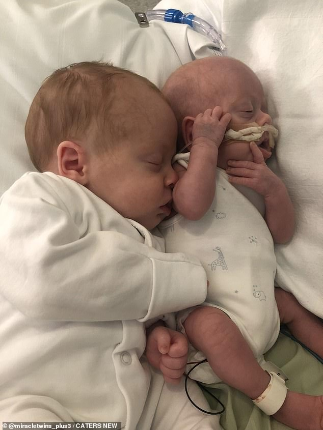 Otis Graves hugging his brother Chester in the hospital.  Identical twins were both born prematurely at 28 weeks on July 15 this year, but Chester was too young due to selective intrauterine growth restriction.
