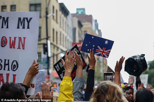 Hundreds gathered outside the Australian consulate building in New York on Monday