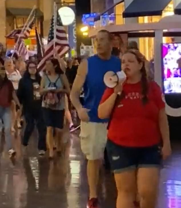The roving group of hundreds of protesters also stopped at the Miracle Mile Shops in the Planet Hollywood complex, carrying American flags and signs reading, 'F*** Joe Biden'