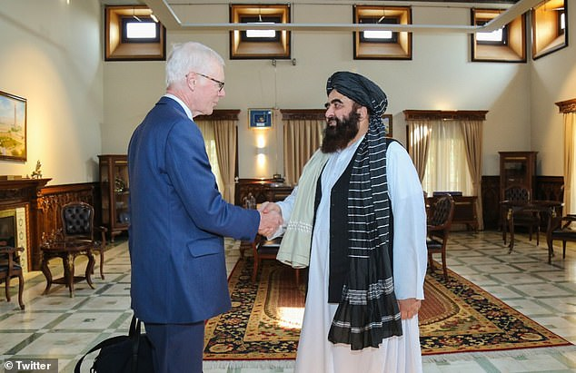Sir Simon Gass, the Prime Minister's High Representative for Afghan Transition, met with terror chiefs in Kabul - the first summit since British forces evacuated in August (pictured: shaking hands with the Taliban foreign ministerAmir Khan Muttaqi on Tuesday)