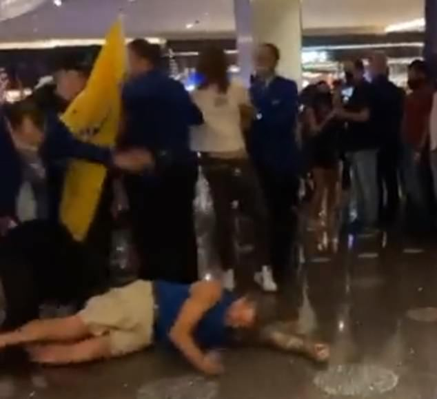 A man threw himself in front of security officers who were trying to detain an anti-vaccine protester at the Cosmopolitan Resort & Casino in Las Vegas on Sunday night