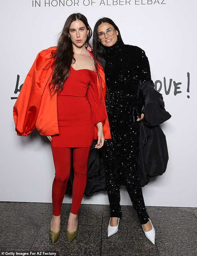 Family:Demi Moore looked in good spirits as attended the Love Brings Love show with her lookalike daughter Scout in honor of Alber Elbaz in Paris, France on Tuesday