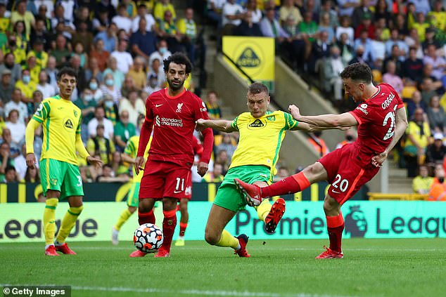 Jota joined Roberto Firmino and Mohamed Salah (left) on the scoresheet at Carrow Road