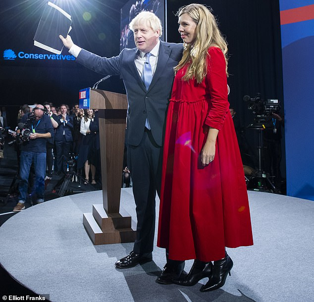 This week, the Prime Minister (pictured with his wife Carrie Johnson) talked down food and fuel shortages and blithely claimed there's 'no shortage' of eager young people who are thinking of becoming lorry drivers
