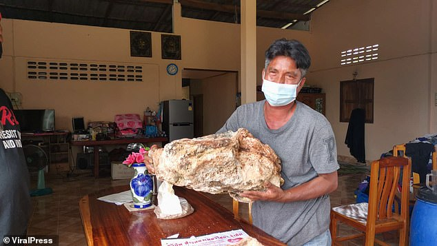 CATCH OF THE DAY! Narong Phetcharaj, who usually earns around £200 a month from fishing, couldn't believe his luck after finding a lump of whale vomit floating off Niyom beach in Surat Thani province, Thailand