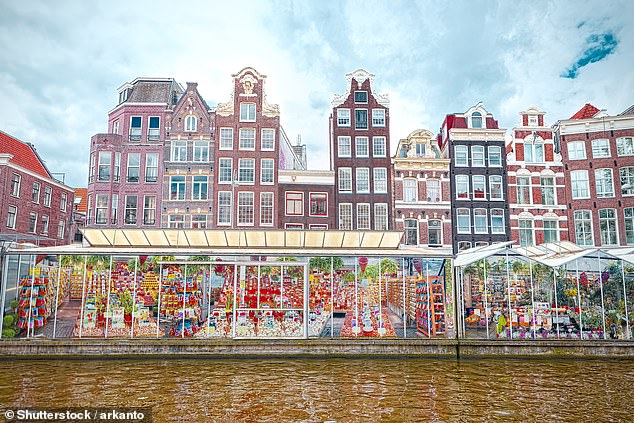 Travelers can visit Amsterdam to see many sights including the Flower Market