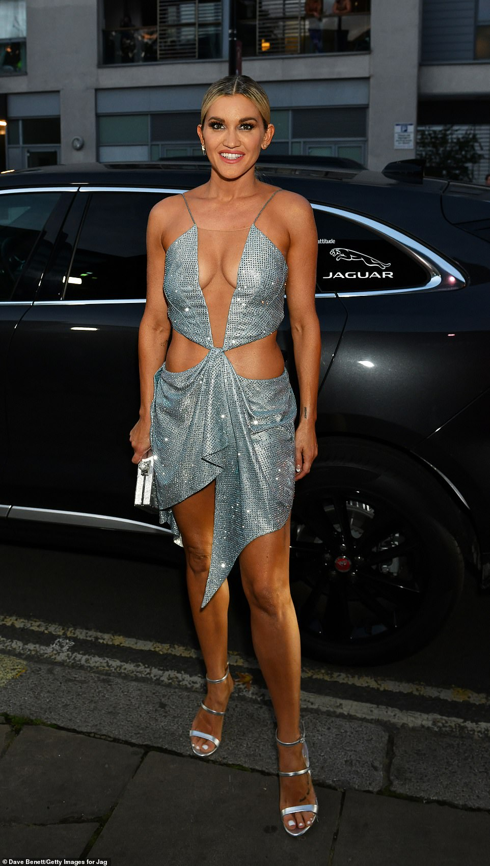 Stunning:Ashley showed off her toned frame in a cut-out silver sequinned dress which left little to the imagination