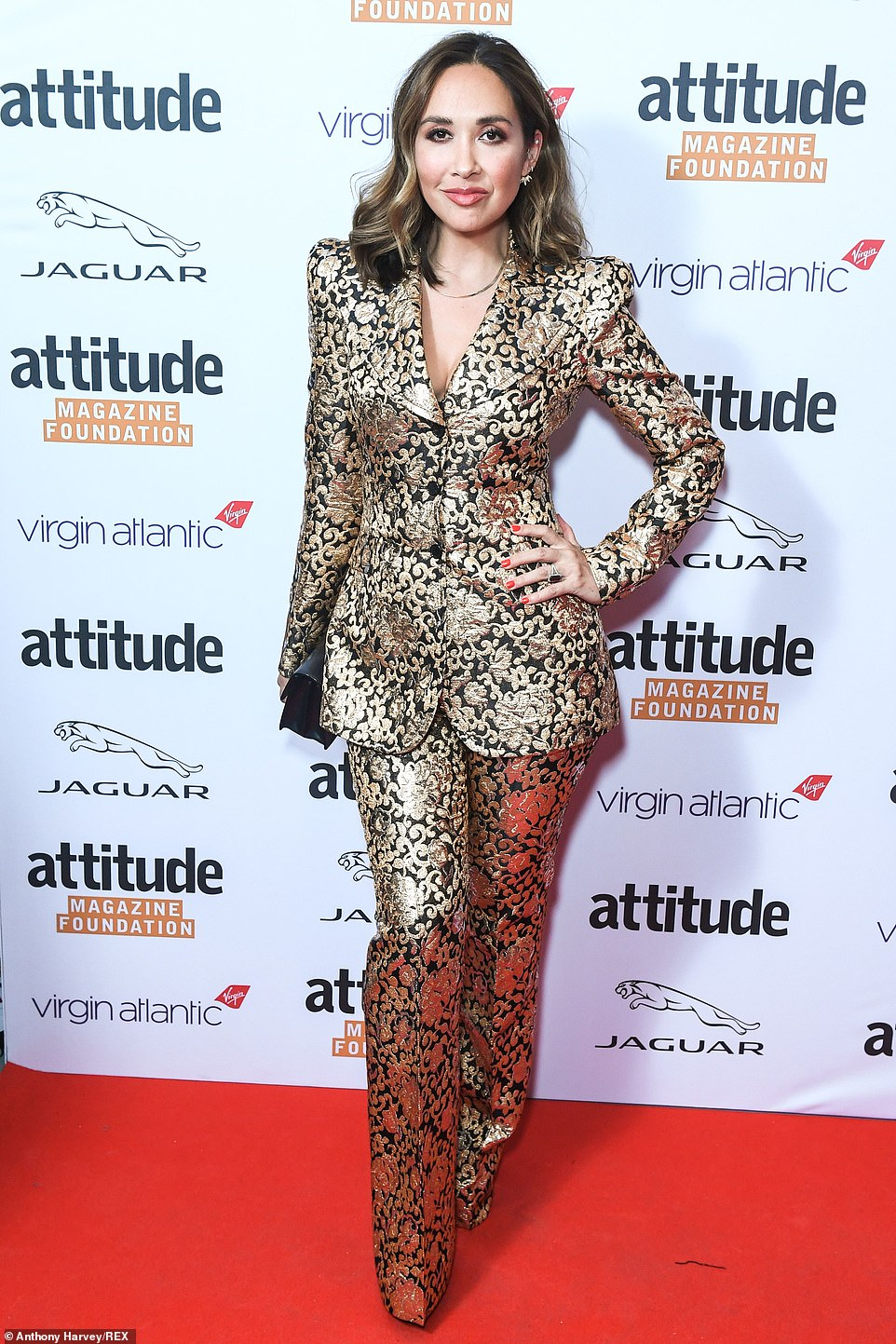 Work it: Myleene looked great in the chic jacket and matching straight-keg trousers