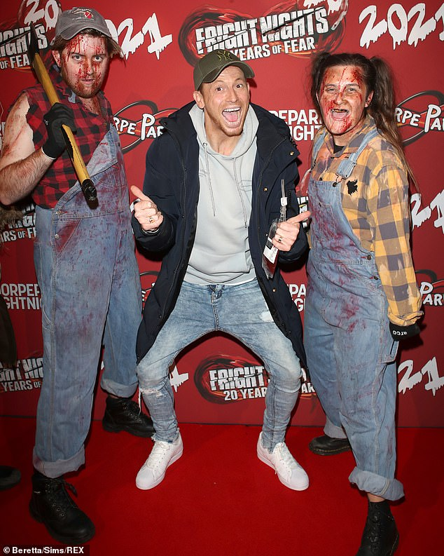 Smiles with pride: Joe Swash, 39, appeared in celebratory mood at Thorpe Park's frat night on Wednesday evening, just days after welcoming daughter with Stacey Solomon, 32.