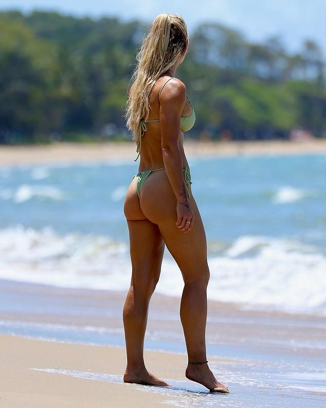 Stunner: The reality star proved that she wasn't shy in the skimpy green bikini