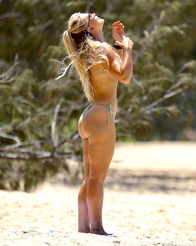 Cheeky: The SAS Australia star,35, looked toned and muscular in a revealing G-string bikini that left little to the imagination
