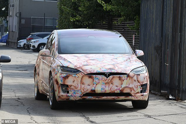Epic! JoJo rolled up to rehearsal in her face-print electric SUV, the Tesla Model X, customized in 2019 by YouTube couple Kyler & Madison Fisher
