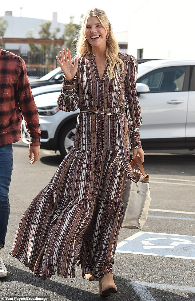 Busy single mom: Also spotted Wednesday was 39-year-old Kloots - who capitalized on her husband Nick Cordero's death in 2020 - wearing a brown striped dress and beige booties