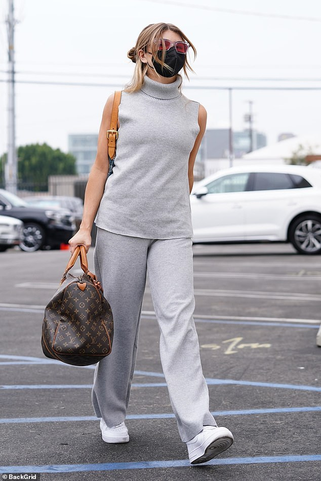 Tied for fourth place:Influencer Olivia Jade Giannulli - whose parents did hard times for the college admission scandal - bared her arms in a sleeveless turtleneck and clutched a Louis Vuitton bag before prepping her Samba and Jazz numbers