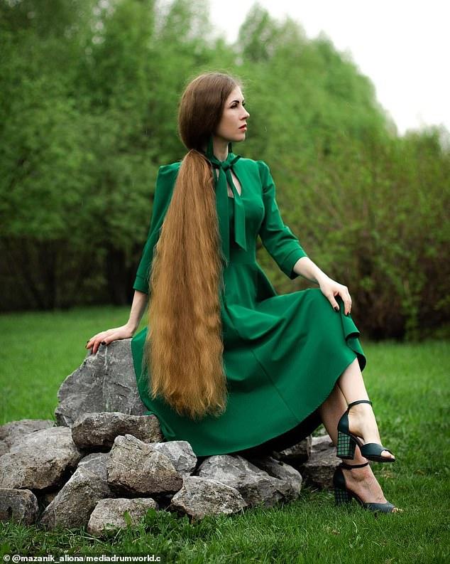 Alina Mazannik, 35, from Leninsk-Kuznetsky, Russia, spends hours looking after her 51-inch-long hair