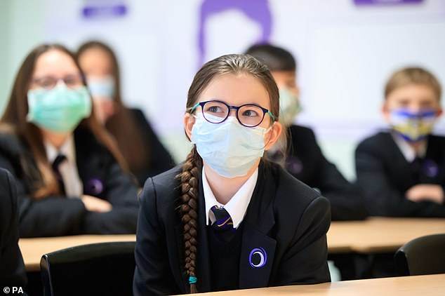 Compulsory wearing of face coverings in schools and colleges was abolished in May.  Some worried that the masks hindered learning, but others warned they were necessary to suppress the outbreak.  Pictured: Children wearing facemasks at Outwood Academy in Doncaster, Yorkshire in March