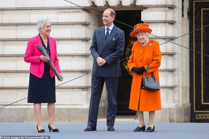 The monarch appeared to be in high spirits after joining Prince Edward at an event in London today