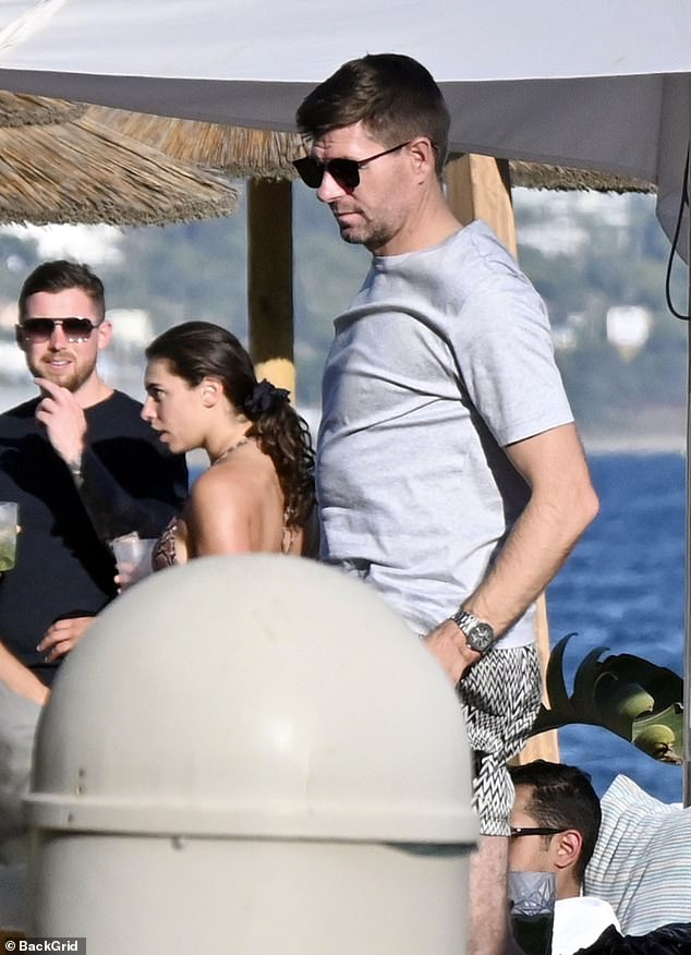 Low-key: Steven Gerrard seems on course to be a fortnight away from the Scottish Premier League as he hits the beach with his wife Alex in Marbella on Wednesday.