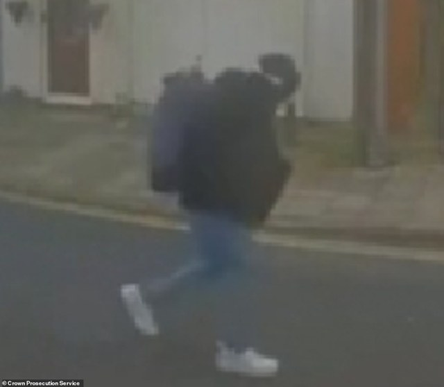Rouf is pictured walking along the road in Brighton